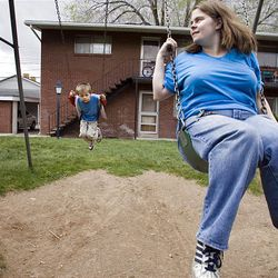 Connie Brown swings with Dylan, 5, while hunting for an apartment in Clearfield after the fire that destroyed their uninsured home. Connie researched and visited apartments while her husband, Russ, worked at his Salt Lake job.