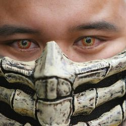 Stephen Burress wears his Scorpion costume at Comic Con in Salt Lake City Thursday, Sept. 5, 2013.