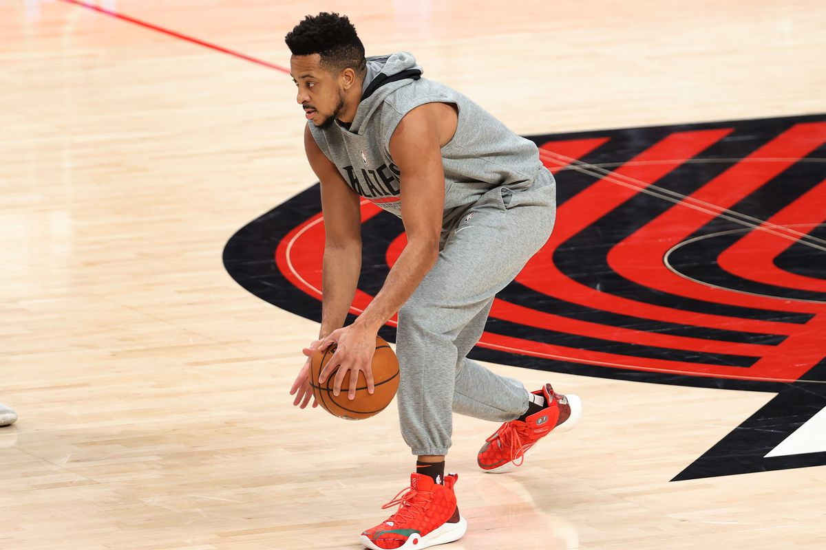 CJ McCollum of the Portland Trail Blazers warms up before the game against the Golden State Warriors at Moda Center on March 03, 2021 in Portland, Oregon.