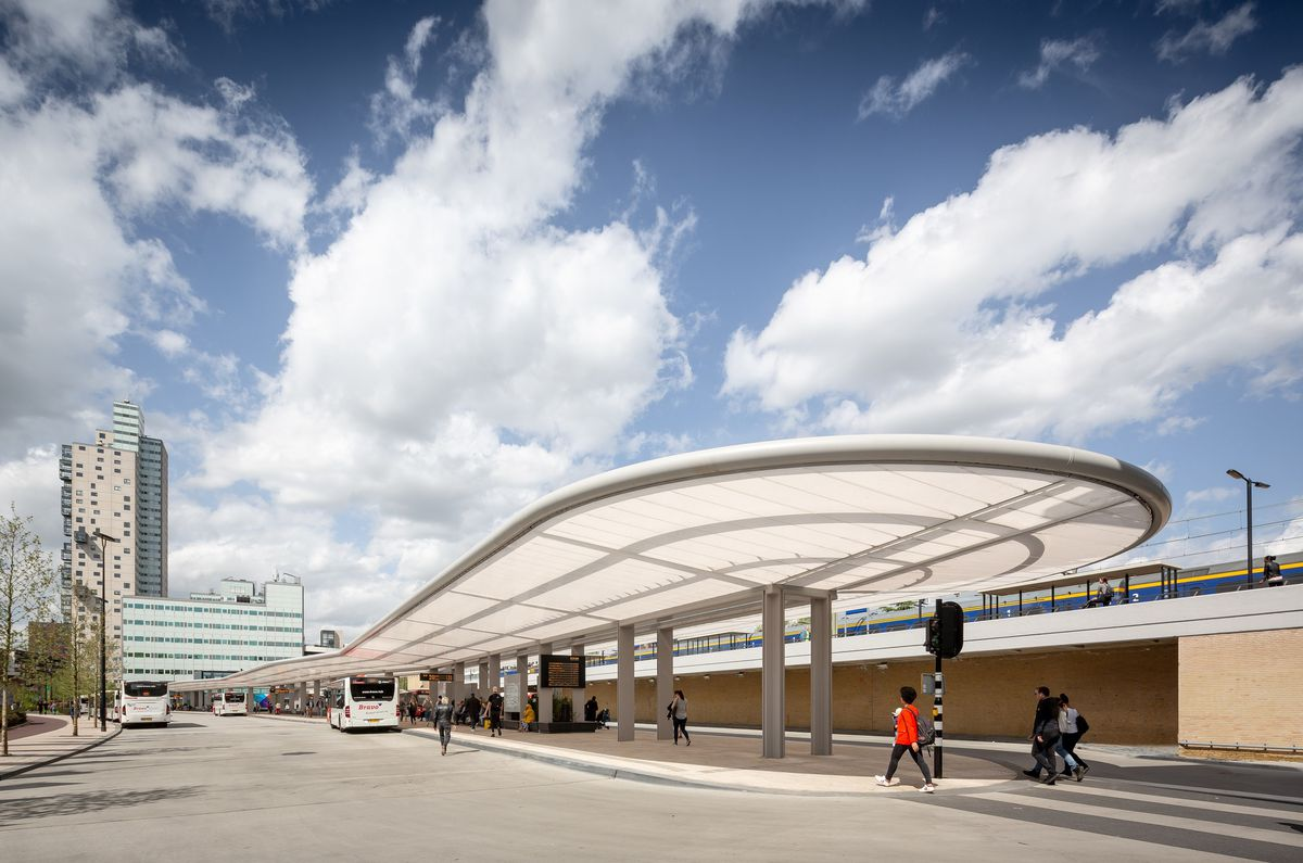 Bus station with curved awning