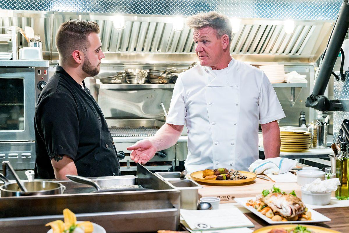 Gordon Ramsay in a restaurant kitchen, talking to a restaurant owner