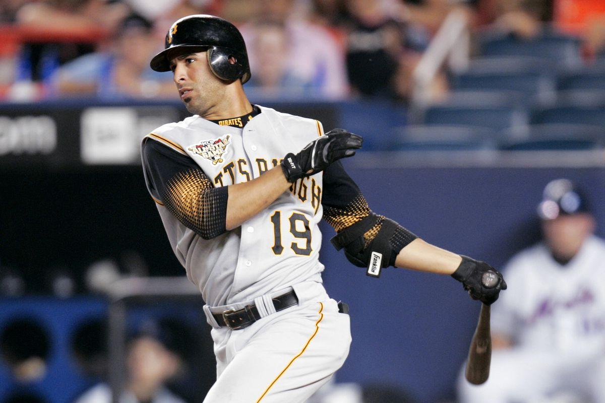 Pittsburgh Pirates' Jose Bautista singles in a run during th