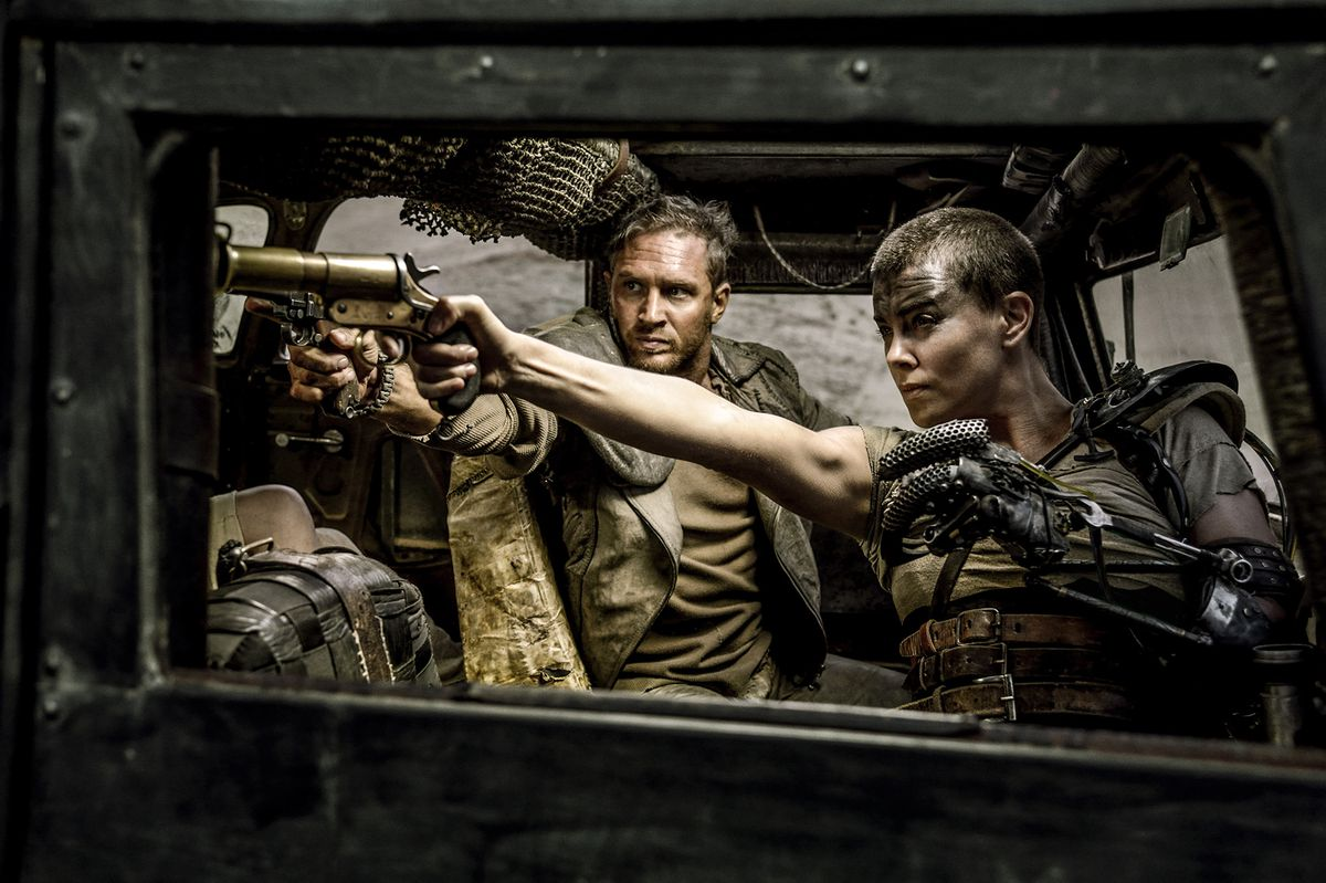 Max and Furiosa aiming pistols from inside a truck in Mad Max: Fury Road