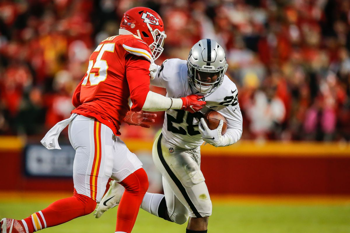 Frank Clark of the Kansas City Chiefs tackles Josh Jacobs of the Oakland Raiders for a loss in the second quarter at Arrowhead Stadium on December 1, 2019 in Kansas City, Missouri.