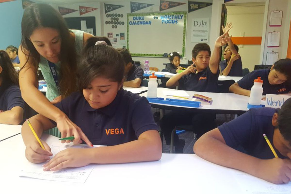 Teacher Gabrielle Mahon works with sixth-graders during a math lesson in September 2018 at Vega Collegiate Academy in Aurora.