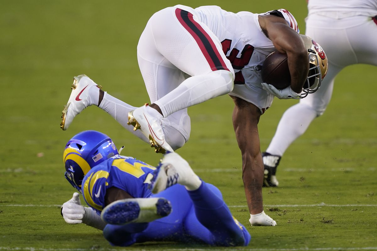 Raheem Mostert #31 of the San Francisco 49ers is tackled by Leonard Floyd #54 of the Los Angeles Rams during the first quarter at Levi's Stadium on October 18, 2020 in Santa Clara, California.