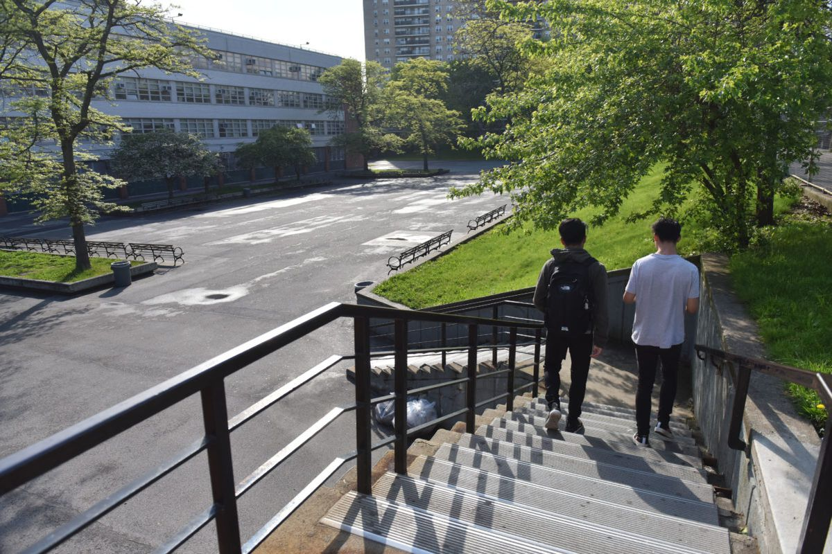 Students walk down the stairs near Bronx High School of Science, a specialized high school in the Bronx.