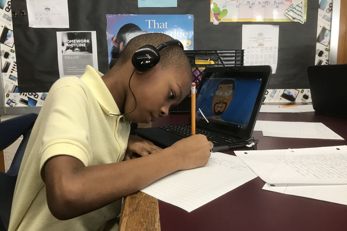 A student at Bagley Elementary School of Journalism and Technology works on a Black History Month project.