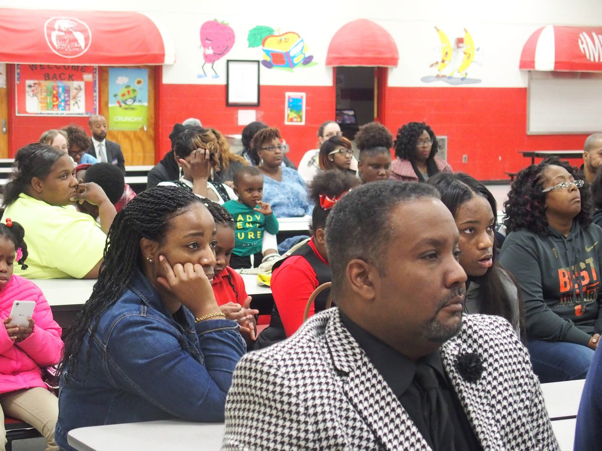 Principal Antonio Harvey, front, and parents listen to a Shelby County Schools presentation on the state's new accountability model.