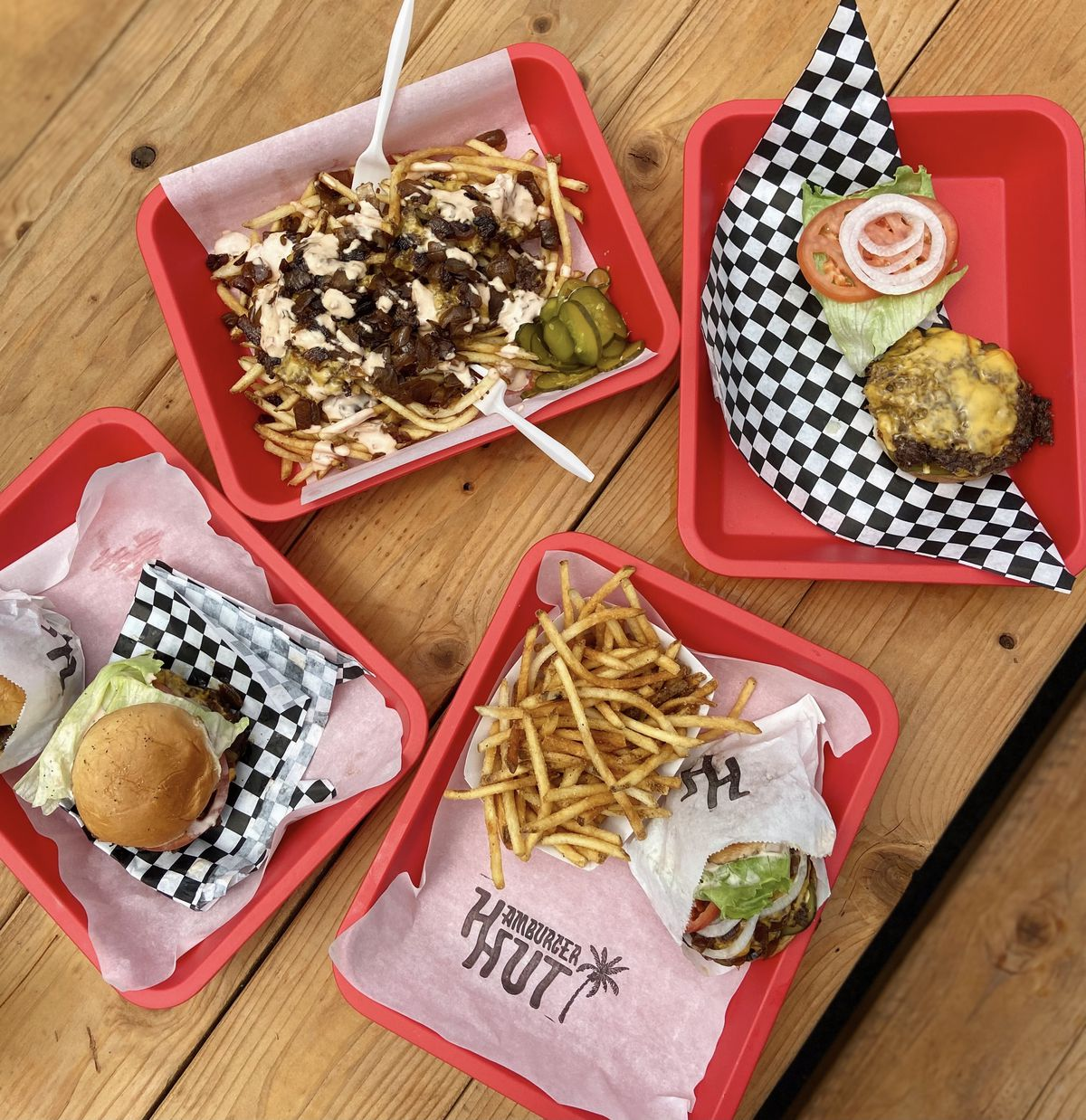 Trays on a table holding burgers and Java fries from Hamburger Hut
