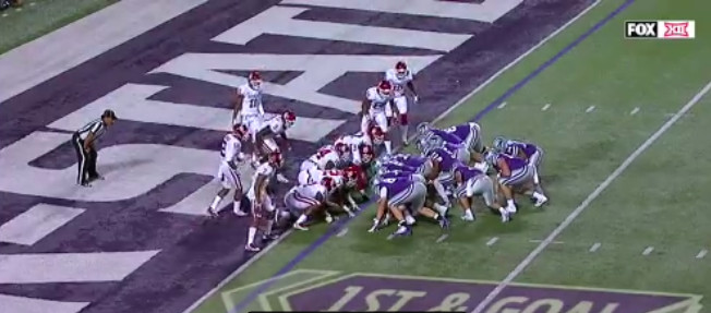 Kansas State lined up against Oklahoma in a QB sneak formation at the goal line