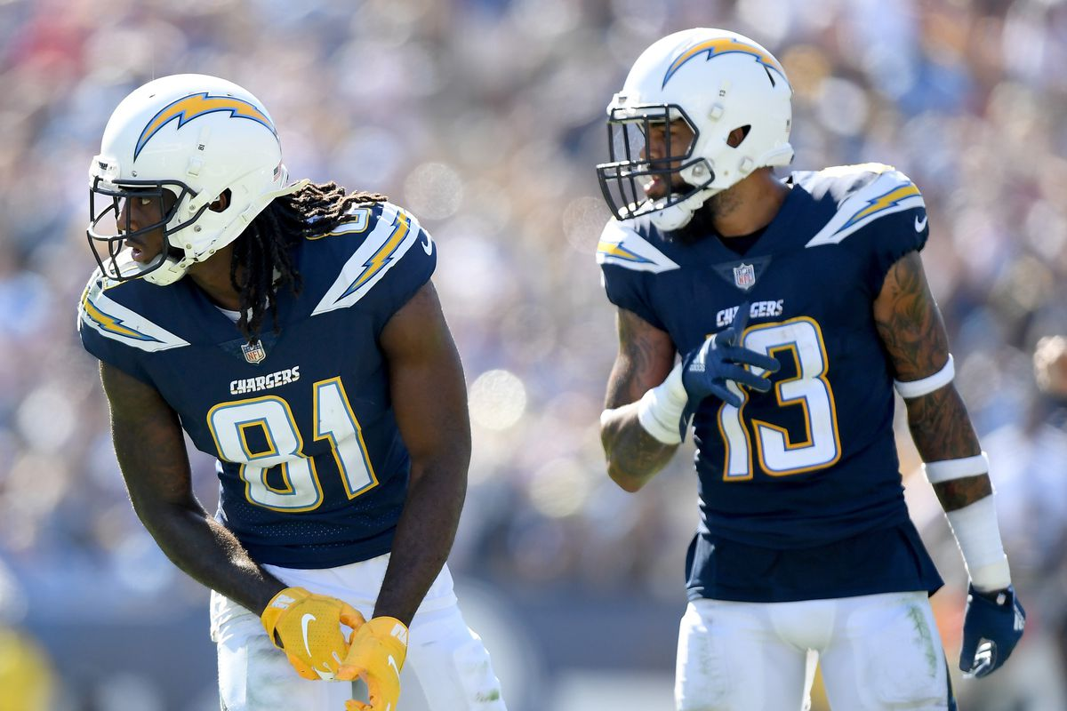 Mike Williams #81 and Keenan Allen #13 of the Los Angeles Chargers line up before the snap against the Los Angeles Rams at Los Angeles Memorial Coliseum on September 23, 2018 in Los Angeles, California.