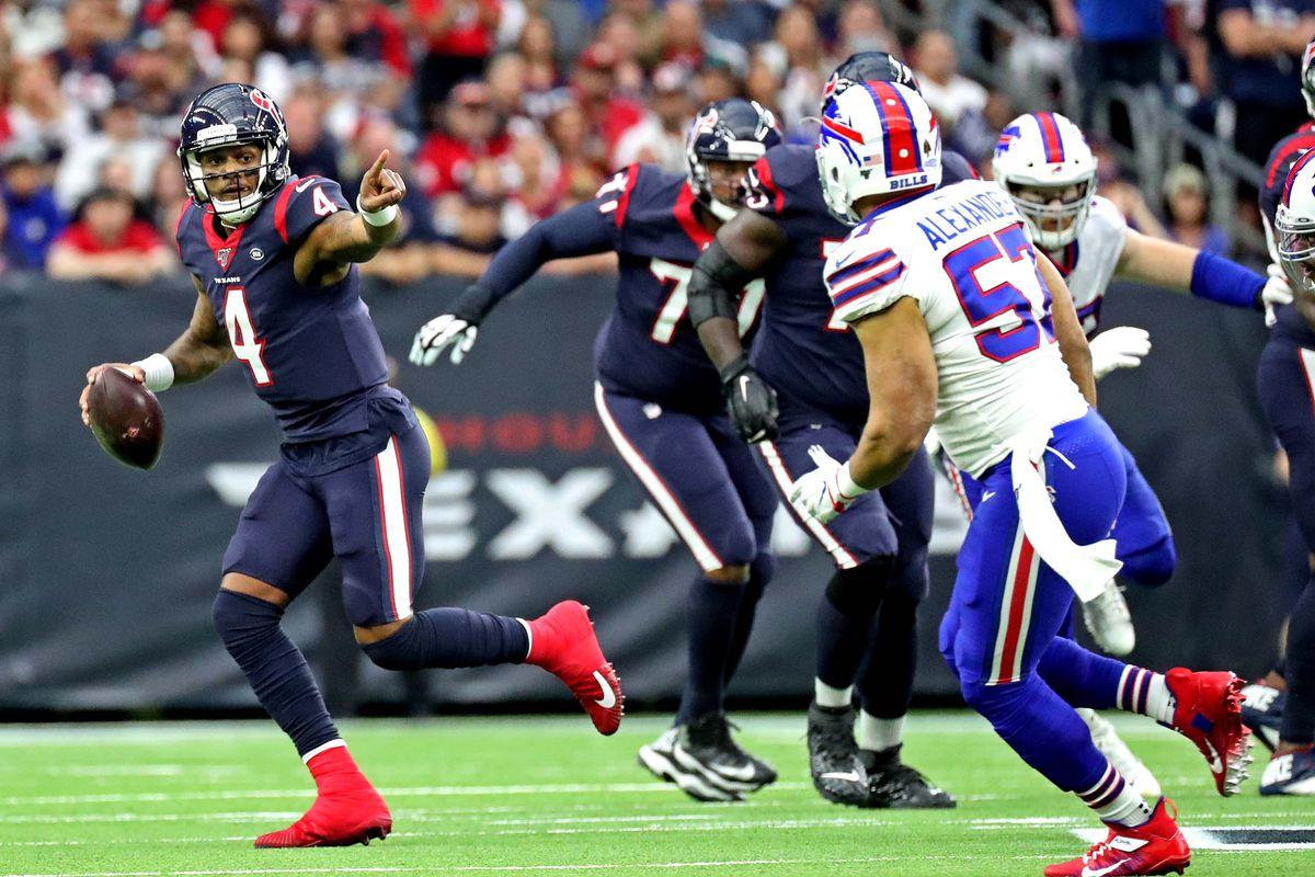 Houston Texans quarterback Deshaun Watson runs the ball against Buffalo Bills outside linebacker Lorenzo Alexander during the first quarter in the AFC Wild Card NFL Playoff game at NRG Stadium.