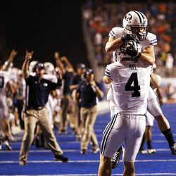 Taysom Hill, back to camera, of the Brigham Young Cougars celebrates scoring BYU's only touchdown during NCAA football in Boise, Thursday, Sept. 20, 2012.