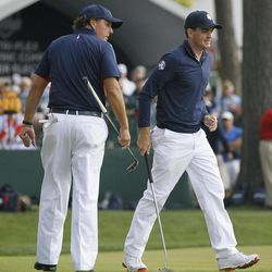 USA's Phil Mickelson and Keegan Bradley putt on the 13th hole during a practice round at the Ryder Cup PGA golf tournament Thursday, Sept. 27, 2012, at the Medinah Country Club in Medinah, Ill.