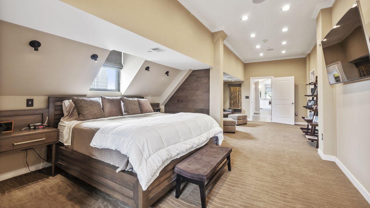 Master bedroom with custom wood headboard
