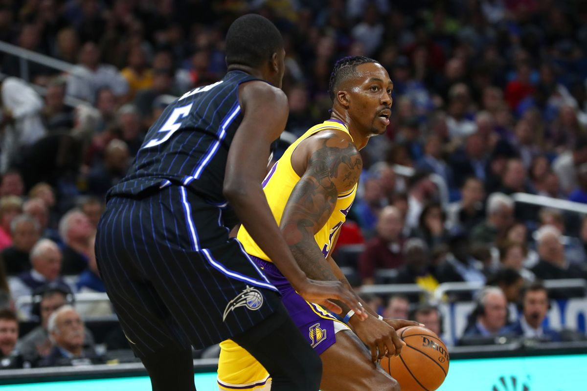 Los Angeles Lakers center Dwight Howard drives to the basket as Orlando Magic center Mo Bamba defends during the second quarter at Amway Center.