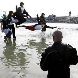 """A group of """"penguins"""" takes part in the Polar Plunge at Utah Lake Saturday, braving the icy waters to raise money for Special Olympics Utah. The chilly event raised $14,000."""
