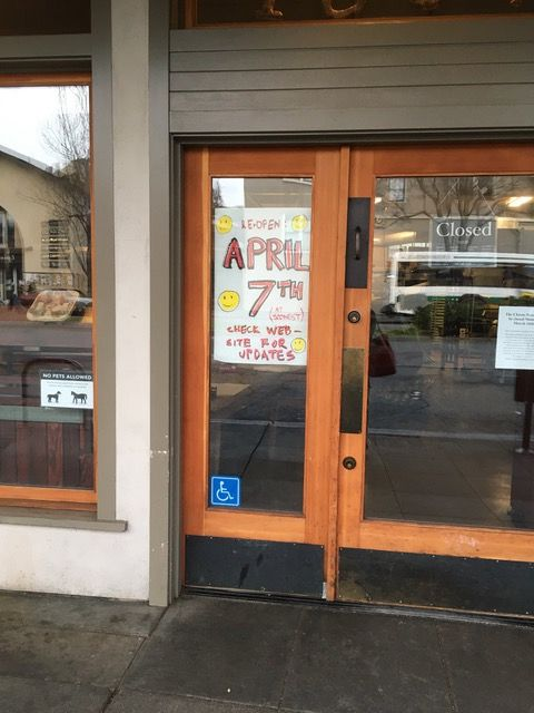 """The sign in the door reads """"Reopen April 7"""""""