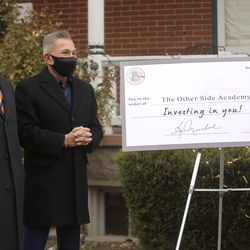 Businessmen K.O. Murdock and David Ibarra pose for a photo after donating $100,000 to The Other Side Academy during a ceremony at the academy in Salt Lake City on Thursday, Dec. 17, 2020. The academy is a 2 1/2-year residential program where those who have been involved in the criminal justice system can learn social, vocational and life skills. The donation will be used to expand the program and remodel a former senior living center that is next door to the academy.