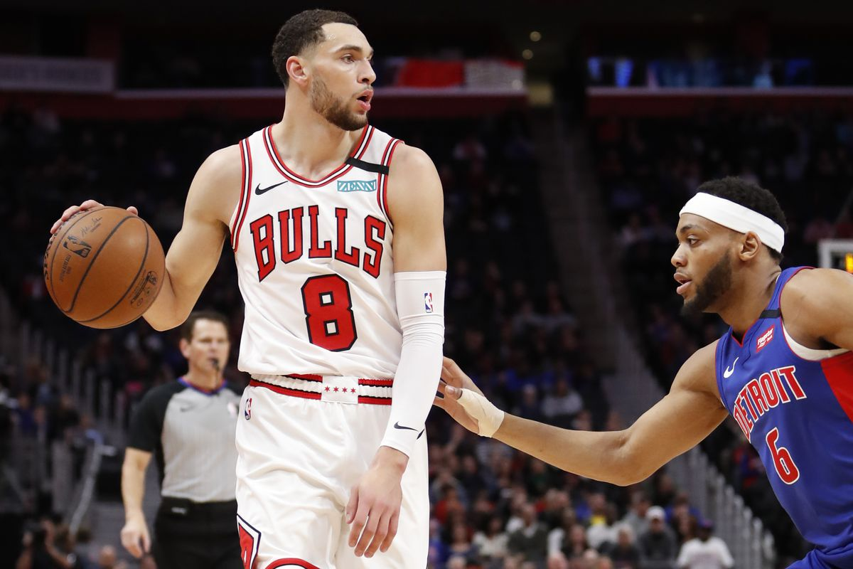 Chicago Bulls guard Zach LaVine handles the ball defended by Detroit Pistons guard Bruce Brown during the first quarter at Little Caesars Arena.