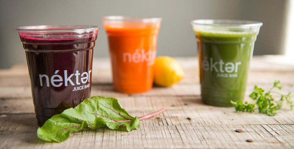 Selection of three juices in plastic cups