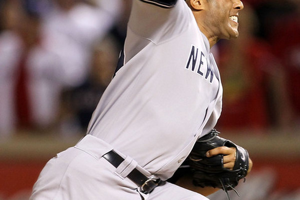 ARLINGTON TX - OCTOBER 22:  Mariano Rivera's arm stayed on after this pitch. (Photo by Stephen Dunn/Getty Images)