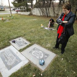 Wilda Thompson visits the graves of family members at the Murray Cemetery in Murray Nov 19, 2014. Several Thompson family members have died of cancer.