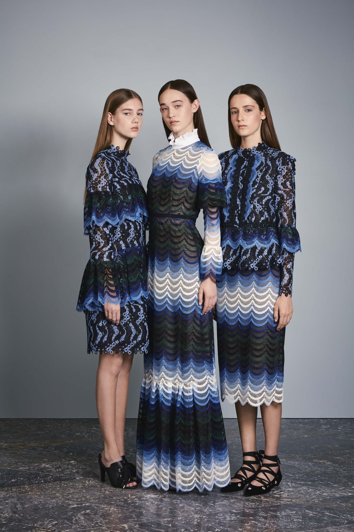 Models wear three blue and white looks, one with a high ruffled collar, in Erdem's resort 2017 lookbook.