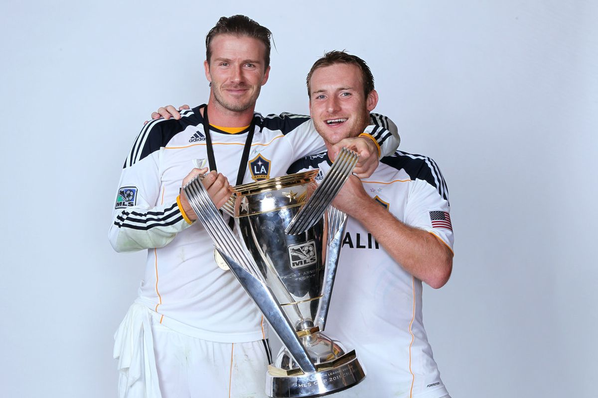 CARSON, CA - NOVEMBER 20:  (L-R) David Beckham #23 and Chris Birchall #8 of the Los Angeles Galaxy pose for a portrait following the 2011 MLS Cup at The Home Depot Center on November 20, 2011 in Carson, California.  (Photo by Jeff Gross/Getty Images)