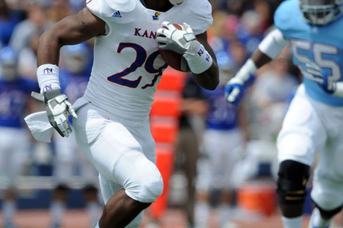 Apr 28, 2012; Lawrence, KS, USA; Kansas Jayhawks running back James Sims (29) carries the ball in the first half of the Spring Game at Memorial Stadium. Mandatory Credit: John Rieger-US PRESSWIRE