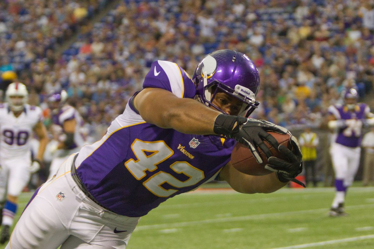 Aug 17, 2012; Minneapolis, MN, USA; Minnesota Vikings running back Jerome Felton (42) dives for a touchdown in the first quater vs the Buffalo Bills at the Metrodome. Mandatory Credit: Brad Rempel-US PRESSWIRE
