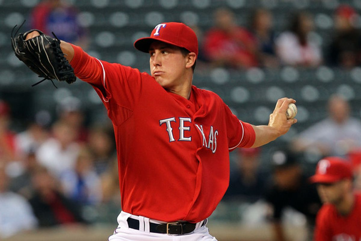 ARLINGTON, TX - MAY 17:  Derek Holland #45 of the Texas Rangers throws against the Los Angeles Angels of Anaheim on May 17, 2010 at Rangers Ballpark in Arlington, Texas.  (Photo by Ronald Martinez/Getty Images)