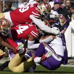 Minnesota Vikings tight end Irv Smith, right, is tackled by San Francisco 49ers cornerback Richard Sherman, left, defensive tackle DeForest Buckner, top, middle linebacker Fred Warner, center, and free safety Jimmie Ward, bottom, during the first half of an NFL divisional playoff football game, Saturday, Jan. 11, 2020, in Santa Clara, Calif.