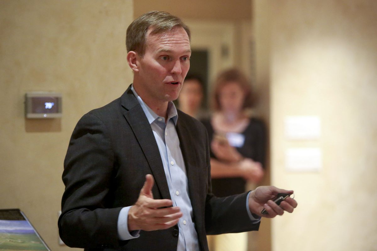 FILE - Salt Lake County Mayor Ben McAdams, 4th Congressional District Democratic candidate, speaks at a neighborhood gathering in Millcreek on Monday, Oct. 1, 2018.