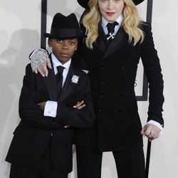 """""""Now let's get the jokes out of the way. I heard pimp, the Quaker Oats man, Mr. Peanut, but let's talk real—Madonna is a trendsetter. Madonna worked with superstar stylist Bea Akerlund and designer Ralph Lauren to create her two looks for the Grammys and"""