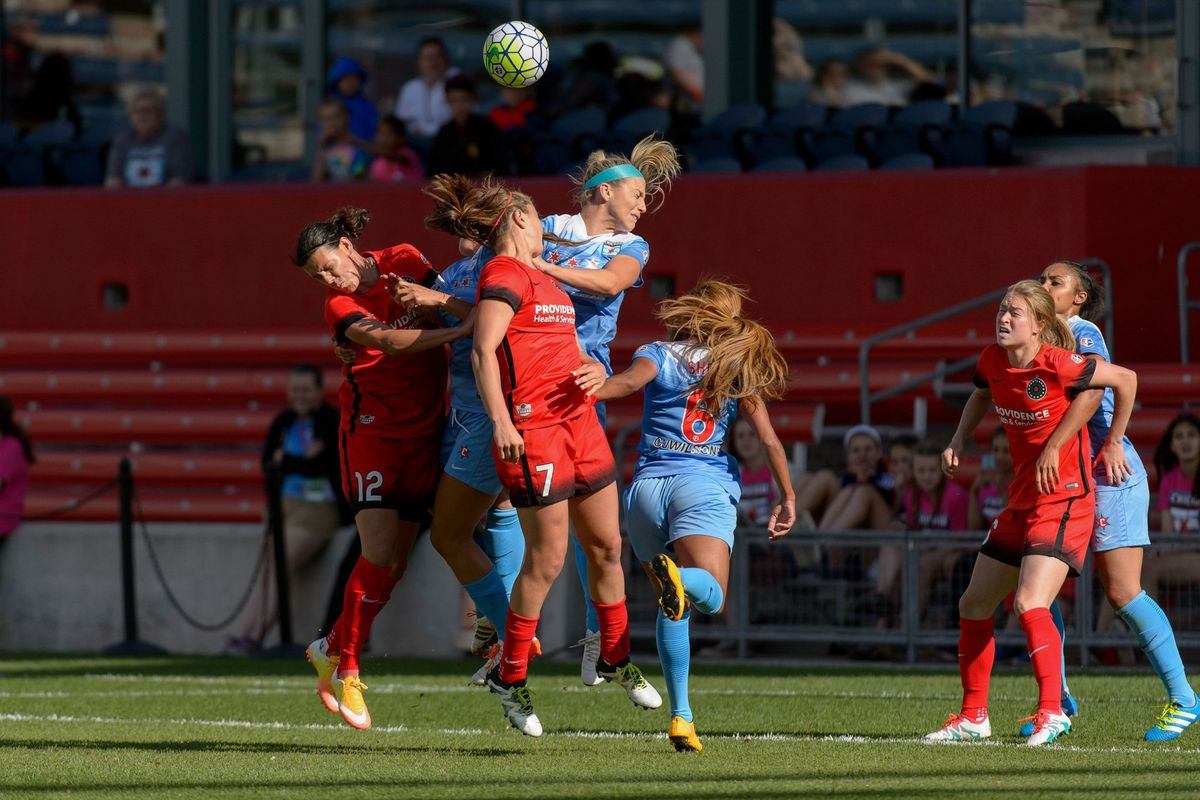 Red Stars and Thorns players battle during a corner kick