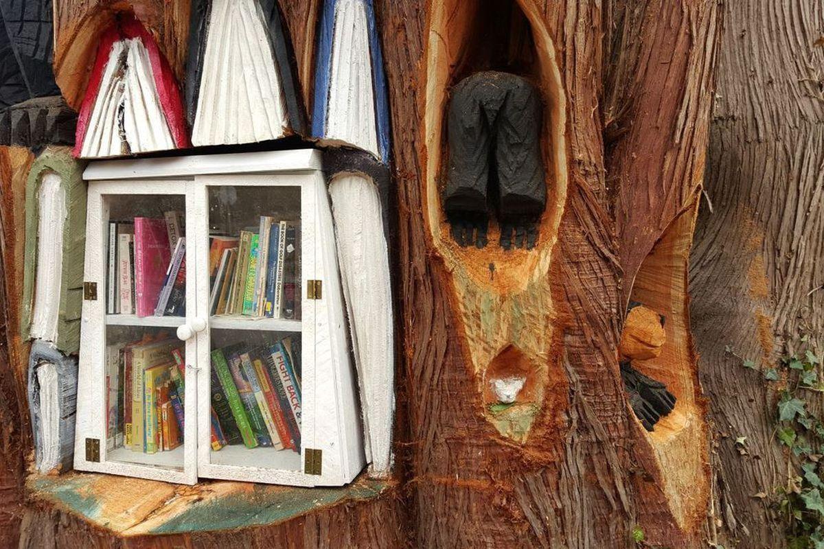 "<a href=""http://timandjeni.com/blog/giant-cedar-tree-repurposed-as-a-little-free-library/"">Image: Tim & Jeni</a>"