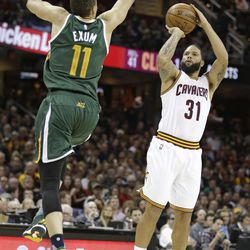 The Cleveland Cavaliers' Deron Williams (31) shoots over Utah Jazz's Dante Exum (11) in the second half of an NBA basketball game Thursday, March 16, 2017, in Cleveland. The Cavaliers won 91-83.