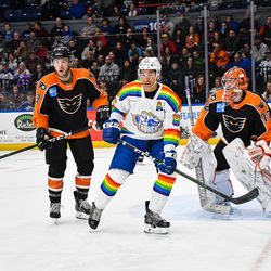 Syracuse Crunch Daniel Walcott (85) in front of Lehigh Valley Phantoms Andy Welinski (3) and goalie Kirill Ustimenko (72) in American Hockey League (AHL) action at the Upstate Medical University Arena in Syracuse, New York on Saturday, February 22, 2020. Syracuse won 2-1.