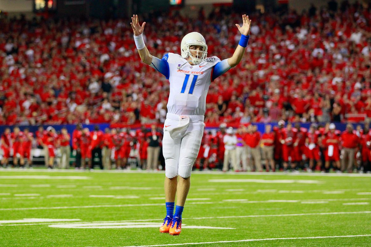 ATLANTA, GA - SEPTEMBER 03:  Kellen Moore #11 of the Boise State Broncos reacts after a touchdown against the Georgia Bulldogs at Georgia Dome on September 3, 2011 in Atlanta, Georgia.  (Photo by Kevin C. Cox/Getty Images)