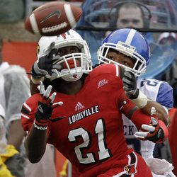 Louisville cornerback Adrian Bushell (21) gets a chance to pick off a pass as Kentucky wide receiver Daryl Collins (23) becomes the defender during first-half action in the season-opening NCAA college football game for both schools at Cardinal Stadium in Louisville, Ky., Sunday, Sept. 2, 2012. The pass was incomplete.