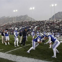 The BYU Cougars get warmed up to play the Utah Utes Saturday.