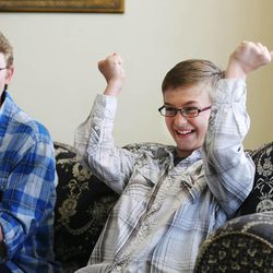 Lincoln and Isaac Evans laugh during a game as they enjoy family home evening Monday, May 11, 2015, together at home in Murray.