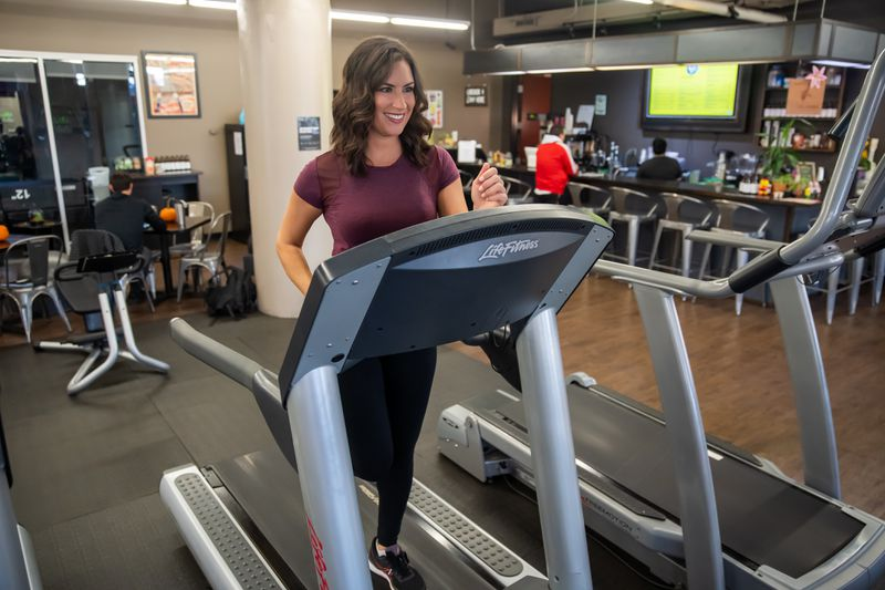 Health and fitness expert Stephanie Mansour is photographed mid-stride on a treadmill at HiFi Fitness at 820 N. Orleans.