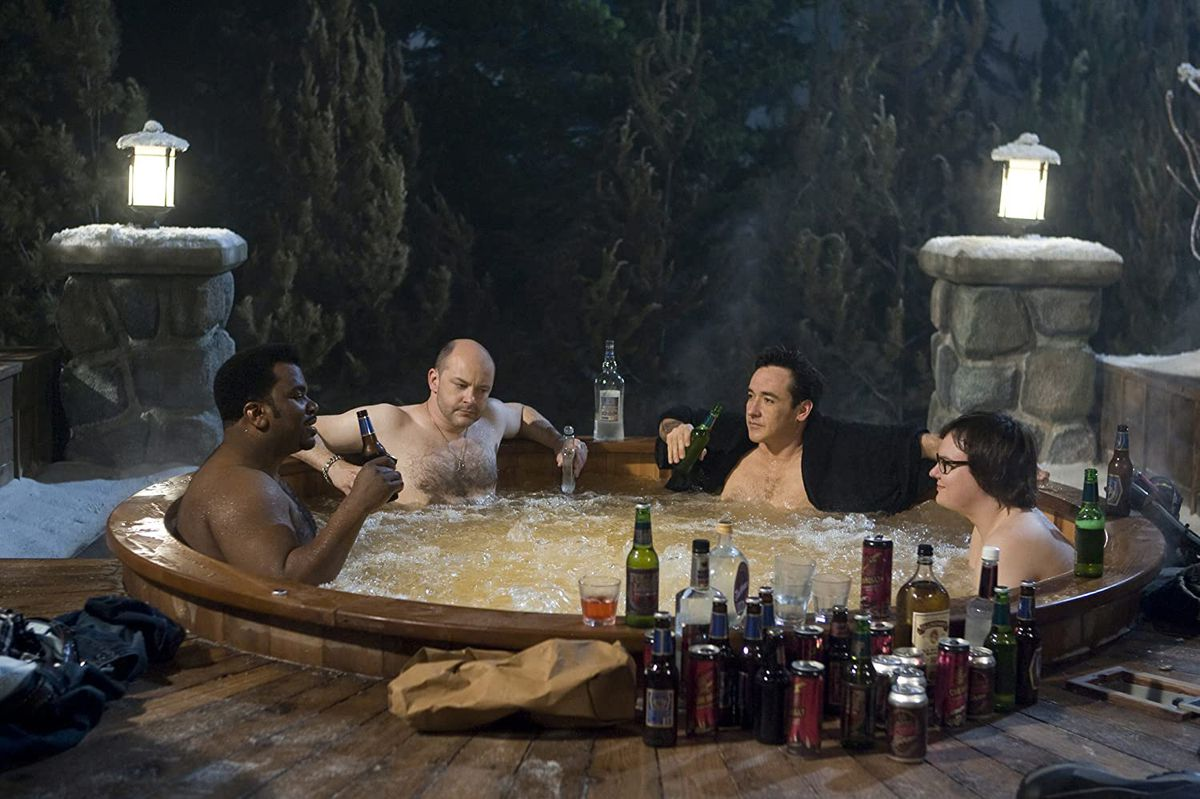 Craig Robinson, Rob Corddry, John Cusack, and Clark Duke drink beers in thee Hot Tub Time Machine