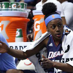 Atlanta's Tiffany Hayes (15) explains a play to a teammate.