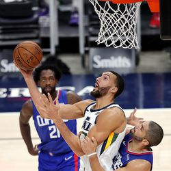 Utah Jazz center Rudy Gobert (27) is fouled by LA Clippers forward Nicolas Batum (33) as the Utah Jazz and LA Clippers play in an NBA basketball game at Vivint Smart Home Arena in Salt Lake City on Friday, Jan. 1, 2021. Utah won 106-100,