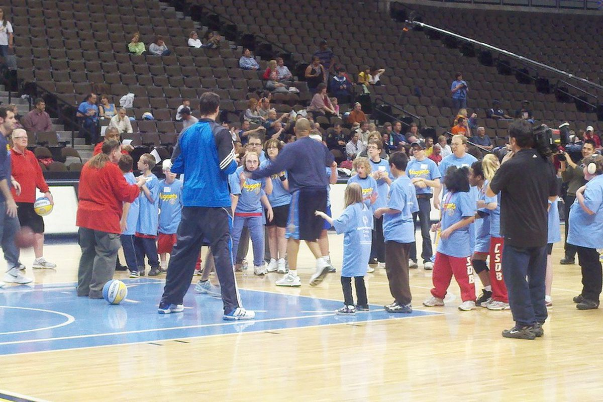 Rudy Fernandez (far left), Danilo Gallinari, and coach Melvin Hunt showing the kids a couple tricks of their basketball trade.