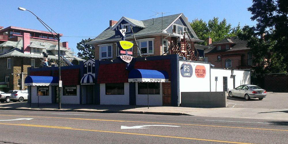 Exterior of an old dive bar on East Colfax